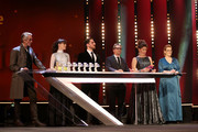 (L-R) President of the International Jury Jeremy Irons, Berenice Bejo, Luca Marinelli, Annemarie Jacir and Bettina Brokemper are seen on stage at the closing ceremony of the 70th Berlinale International Film Festival Berlin at Berlinale Palace on February 29, 2020 in Berlin, Germany.