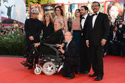 (L-R) Japanese composer, musician and producer Ryuichi Sakamoto, British director Andrea Arnold, German actress Martina Gedeck, French actress Virginie Ledoyen, Chilean director, screenwriter and producer Pablo Larrain, Chinese actor and director Jiang Wen, Italian director and president of the jury Bernardo Bertolucci and Swiss French director of photography Renato Berta attend the Closing Ceremony during the 70th Venice International Film Festival at the Palazzo del Cinema on September 7, 2013 in Venice, Italy.