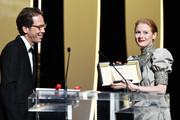 """Emily Beecham receives the Best Actress award for her role in """"Little Joe"""" from Reda Kated during the Closing Ceremony of the 72nd annual Cannes Film Festival on May 25, 2019 in Cannes, France."""