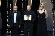 """President of the Camera d'or jury Rithy Panh (L) and Valeria Bruni Tedeschi (R) present Cesar Diaz (C)  with the Camera d'Or award for the film """"Nuestras Madres"""" at the Closing Ceremony during the 72nd annual Cannes Film Festival on May 25, 2019 in Cannes, France."""