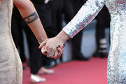 """Kristen Stewart and Léa Seydoux, fashion detail, attend the Closing Ceremony & screening of """"The Man Who Killed Don Quixote"""" during the 71st annual Cannes Film Festival at Palais des Festivals on May 19, 2018 in Cannes, France."""