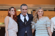 (L-R) Actress Kristen Stewart, director Olivier Assayas and actress Chloe Grace Moretz attend the 'Clouds Of Sils Maria' premiere during the 67th Annual Cannes Film Festival on May 23, 2014 in Cannes, France.