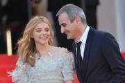 Chloe Grace Moretz (L) and director Olivier Assayas attend the 'Clouds Of Sils Maria' premiere during the 67th Annual Cannes Film Festival on May 23, 2014 in Cannes, France.
