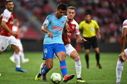 Rodri #14 of Atletico Madrid and Aaron Ramsey #8 of Arsenal competes for the ball during the International Champions Cup 2018 match between Club Atletico de Madrid and Arsenal at the National Stadium on July 26, 2018 in Singapore.