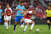 Aaron Ramsey #8 of Arsenal and Rodri #14 of Atletico Madrid competes for the ball during the International Champions Cup 2018 match between Club Atletico de Madrid and Arsenal at the National Stadium on July 26, 2018 in Singapore.