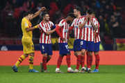 Koke, Thomas Lemar and Vitolo of Atletico Madrid react in defeat after the Liga match between Club Atletico de Madrid and FC Barcelona at Wanda Metropolitano on December 01, 2019 in Madrid, Spain.