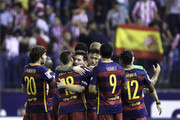 Lionel Messi (3dL) of FC Barcelona and his teammate Neymar JR. (3dR) celebrates with teammates after winning the La Liga match between Club Atletico de Madrid and FC Barcelona at Vicente Calderon Stadium on September 12, 2015 in Madrid, Spain.