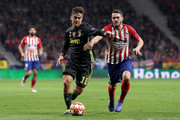 Paulo Dybala of Juventus challenges for the ball with Koke of Atletico Madrid during the UEFA Champions League Round of 16 First Leg match between Club Atletico de Madrid and Juventus at Estadio Wanda Metropolitano on February 20, 2019 in Madrid, Spain.