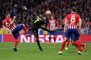 Cristiano Ronaldo of Juventus attempts to control the ball from Koke of Atletico Madrid during the UEFA Champions League Round of 16 First Leg match between Club Atletico de Madrid and Juventus at Estadio Wanda Metropolitano on February 20, 2019 in Madrid, Spain.