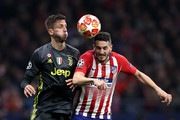 Koke of Atletico Madrid challenges for the ball with Rodrigo Bentancur of Juventus during the UEFA Champions League Round of 16 First Leg match between Club Atletico de Madrid and Juventus at Estadio Wanda Metropolitano on February 20, 2019 in Madrid, Spain.