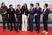 """(L-R) Author Albert Espinosa, Juergen Vogel, Nick Julius Schuck, Luise Befort, Tim Oliver Schultz, Damian Hardung and Ivo Kortlang attend the German premiere of the film """"Club der Roten Baender - Wie alles begann"""" at Cinedom on February 04, 2019 in Cologne, Germany."""