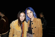 Yoyo Cao (L) and Irene Kim attend Coach Spring 2018 fashion show during New York Fashion Week at Basketball City - Pier 36 - South Street on September 12, 2017 in New York City.