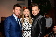 """(L-R) Writer/director Taylor Sheridan, actors Elizabeth Olsen and Jeremy Renner attend a cocktail party for """"Wind River"""" at Circa 55 Restaurant on December 2, 2017 in Los Angeles, California."""