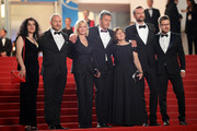 "Producer Tanya Seghatchian, actor Borys Szyc, actress Joanna Kulig, director Pawel Pawlikowski, producer Ewa Puszczynska, actor Tomasz Kot and guest attend the screening of ""Cold War (Zimna Wojna)"" during the 71st annual Cannes Film Festival at Palais des Festivals on May 10, 2018 in Cannes, France."