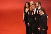 "Producer Tanya Seghatchian, actor Borys Szyc, actress Joanna Kulig, director Pawel Pawlikowski,actor Tomasz Kot, producer Ewa Puszczynska and guest (R) attend the screening of ""Cold War (Zimna Wojna)"" during the 71st annual Cannes Film Festival at Palais des Festivals on May 10, 2018 in Cannes, France."