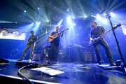 (L-R) Musicians Jonny Buckland, Chris Martin, Will Champion and Guy Berryman of Coldplay perform onstage during their iHeartRadio Album Release Party at the iHeartRadio Theater Los Angeles on May 16, 2014 in Burbank, California. Streaming Live on Yahoo Screen and Clear Channel stations across the country.