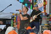 "Singer Chris Martin (L) and guitarist Jonny Buckland of Coldplay perform on NBC's ""Today"" at Rockefeller Plaza on March 14, 2016 in New York City."