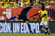 Bobby Wood #7 of Unites States and Davinson S?nchez #23 of Colombia fight for the ball during an International Friendly  at Raymond James Stadium on October 11, 2018 in Tampa, Florida.