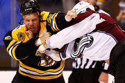 Shawn Thornton #22 of the Boston Bruins fights Patrick Bordeleau #58 of the Colorado Avalanche in the second period during the game on October 10, 2013 at TD Garden in Boston, Massachusetts.