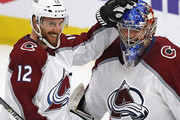 Patrik Nemeth #12 and Semyon Varlamov #1 of the Colorado Avalanche.celebrate a win over the Chicago Blackhawks at the United Center on March 20, 2018 in Chicago, Illinois. The Avalanche defeated the Blackhawks 5-1.