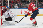 Goaltender Semyon Varlamov #1 of the Colorado Avalanche guards the post as Jamie McGinn #88 of the Florida Panthers skates in on net at the BB&T Center on December 9, 2017 in Sunrise, Florida. The Avalanche defeated the Panthers 7-3.