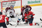 Erik Johnson #6 of the Colorado Avalanche takes Vincent Trocheck #21 of the Florida Panthers to the ice in front of Goaltender Semyon Varlamov #1 during third period action at the BB&T Center on December 9, 2017 in Sunrise, Florida. The Avalanche defeated the Panthers 7-3.