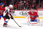 Carey Price #31 of the Montreal Canadiens stops the puck in front of former teammate Daniel Briere #48 of the Colorado Avalanche during the NHL game at the Bell Centre on October 18, 2014 in Montreal, Quebec, Canada.
