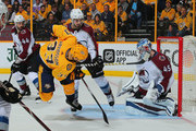Viktor Arvidsson #33 of the Nashville Predators gets upended by Alexander Kerfoot #13 of the Colorado Avalanche in front of Avalanche goalie Jonathan Bernier #45 during the third period of a 5-2 Predators victory in Game One of the Western Conference First Round during the 2018 NHL Stanley Cup Playoffs at Bridgestone Arena on April 12, 2018 in Nashville, Tennessee.