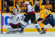 Goalie Jonathan Bernier #45 of the Colorado Avalanche makes a save on a shot by Nick Bonino #13 of the Nashville Predators during the first period in Game Two of the Western Conference First Round during the 2018 NHL Stanley Cup Playoffs at Bridgestone Arena on April 14, 2018 in Nashville, Tennessee.