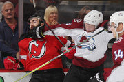 Erik Johnson #6 of the Colorado Avalanche gets the glove up on Kyle Palmieri #21 of the New Jersey Devils during the first period at the Prudential Center on October 18, 2018 in Newark, New Jersey.