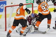 Semyon Varlamov #1 of the Colorado Avalanche makes an arm save late in the third period as Sean Couturier #14 and Jakub Voracek #93 of the Philadelphia Flyers look for the rebound at the Wells Fargo Center on October 22, 2018 in Philadelphia, Pennsylvania. The Avalanche defeated the Flyers 4-1.