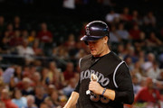 Justin Morneau #33 of the Colorado Rockies scores a second inning run against the Arizona Diamondbacks during the MLB game at Chase Field on September 30, 2015 in Phoenix, Arizona.