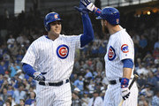 Anthony Rizzo (L) of the Chicago Cubs is greeted by Ben Zobrist #18 of the Chicago Cubs after hitting a home run against the Colorado Rockies during the first inning on May 1, 2018 at Wrigley Field  in Chicago, Illinois.