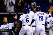 Lorenzo Cain #6 and Danny Valencia #19 of the Kansas City Royals are congratulated by Eric Hosmer #35 after Cain hit a 2-run home run during the game against the Colorado Rockies at Kauffman Stadium on May 13, 2014 in Kansas City, Missouri.