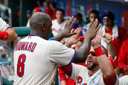 Ryan Howard #6 of the Philadelphia Phillies is congratulated by teammates in the dugout after scoring a run in the sixth inning of the game against the Colorado Rockies at Citizens Bank Park on August 14, 2016 in Philadelphia, Pennsylvania. The Phillies won 7-6.