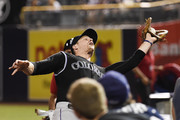 Justin Morneau #33 of the Colorado Rockies makes the catch on a foul ball off the bat of Derek Norris of the San Diego Padres during the sixth inning of a baseball game at Petco Park September 8, 2015 in San Diego, California.