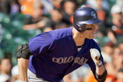 Pinch hitter Justin Morneau #33 Colorado Rockies takes off running after hitting the go-ahead run on a double in the ninth inning at AT&T Park on October 4, 2015 in San Francisco, California, during the final day of the regular season.  The Rockies won 7-3.