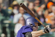 Pinch hitter Justin Morneau #33 Colorado Rockies follows through on a double for the go-ahead run with the bases loaded in the ninth inning at AT&T Park on October 4, 2015 in San Francisco, California, during the final day of the regular season.  The Rockies won 7-3.