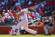 Matt Holliday #7 of the St. Louis Cardinals hits an RBI double against the Colorado Rockies in the third inning at Busch Stadium on September 14, 2014 in St. Louis, Missouri.