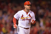 Matt Holliday #7 of the St. Louis Cardinals rounds the bases after hitting a home run in the first inning against the Colorado Rockies at Busch Stadium on September 12, 2014 in St. Louis, Missouri. The Cardinals defeated the Rockies 5-1.