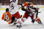 Brandon Dubinsky #17 of the Columbus Blue Jackets and Sean Couturier #14 of the Philadelphia Flyers battle for the puck during the second period at Wells Fargo Center on March 13, 2017 in Philadelphia, Pennsylvania.