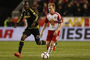 Dax McCarty #11 of New York Red Bulls drives by Kei Kamara #23 of Columbus Crew during their match at Red Bull Arena on November 29, 2015 in Harrison, New Jersey.