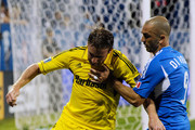 Marco Di Vaio #9 of the Montreal Impact and Chris Birchall #8 of the Columbus Crew battle for the ball during the match at the Saputo Stadium on July 8, 2012 in Montreal, Quebec, Canada.  The Impact defeated the Crew 2-1.
