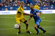 Chad Marshall #14 of the Columbus Crew and Marco Di Vaio #9 of the Montreal Impact battle for the ball during the match at the Saputo Stadium on July 8, 2012 in Montreal, Quebec, Canada.  The Impact defeated the Crew 2-1.