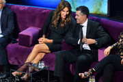 Caitlyn Jenner (L) and Adam Carolla react onstage during the Comedy Central Roast of Alec Baldwin at Saban Theatre on September 07, 2019 in Beverly Hills, California.