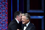 (L-R) Adam Carolla hugs Alec Baldwin onstage during the Comedy Central Roast of Alec Baldwin at Saban Theatre on September 07, 2019 in Beverly Hills, California.