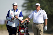 Colin Montgomerie of Scotland waits with his caddie Jason Hempelman on the ninth hole during the Pro Am prior to the start of the Commercialbank Qatar Masters at Doha Golf Club on January 27, 2010 in Doha, Qatar.