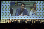 Director Bryan Singer (seen on conference-room screen) speaks onstage at the 20th Century FOX panel during Comic-Con International 2015 at the San Diego Convention Center on July 11, 2015 in San Diego, California.