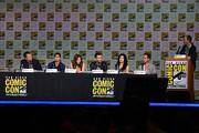 """(L-R) Actors Robert Patrick, Elyes Gabel, Katharine McPhee, Eddie Kaye Thomas, and Jadyn Wong, writer Nicholas Wootton, and moderator Ben Blacker speak onstage at the CBS TV Studios' panel for """"Scorpion"""" during Comic-Con International 2015 at the San Diego Convention Center on July 9, 2015 in San Diego, California."""
