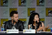 """(L-R) Actors Eddie Kaye Thomas and Jadyn Wong speak onstage at the CBS TV Studios' panel for """"Scorpion"""" during Comic-Con International 2015 at the San Diego Convention Center on July 9, 2015 in San Diego, California."""